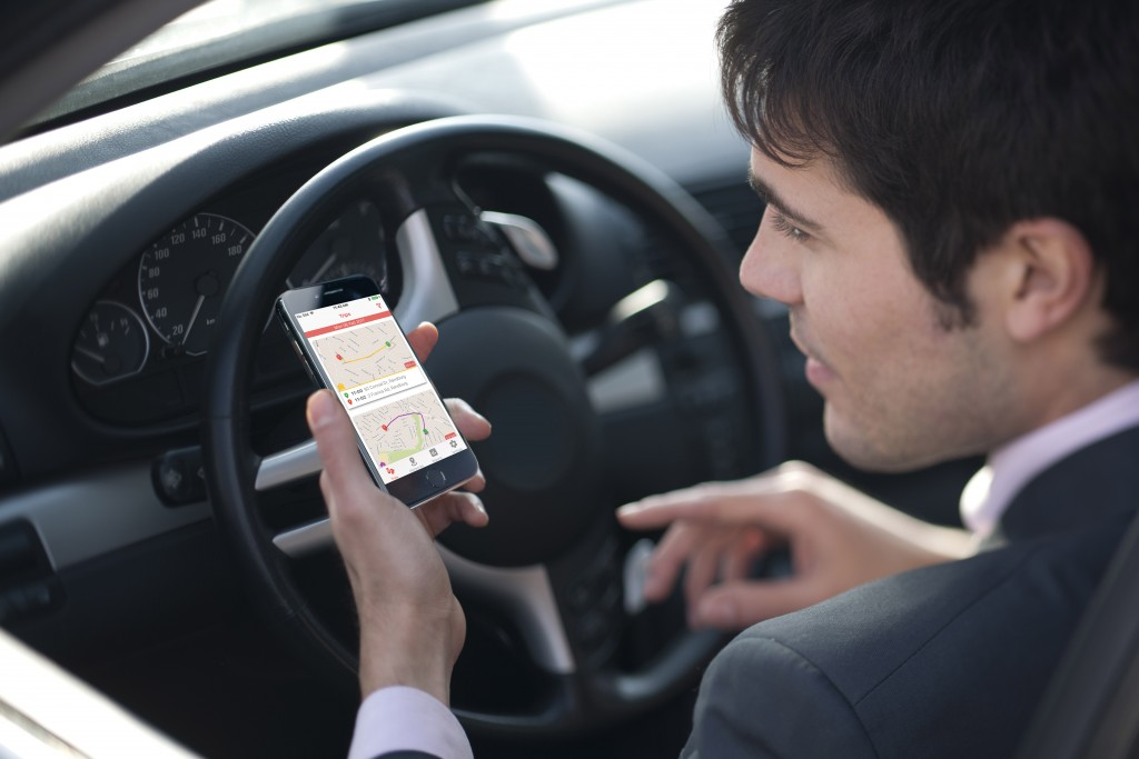 7247464 - driver checking the right way on his mobile phone gps