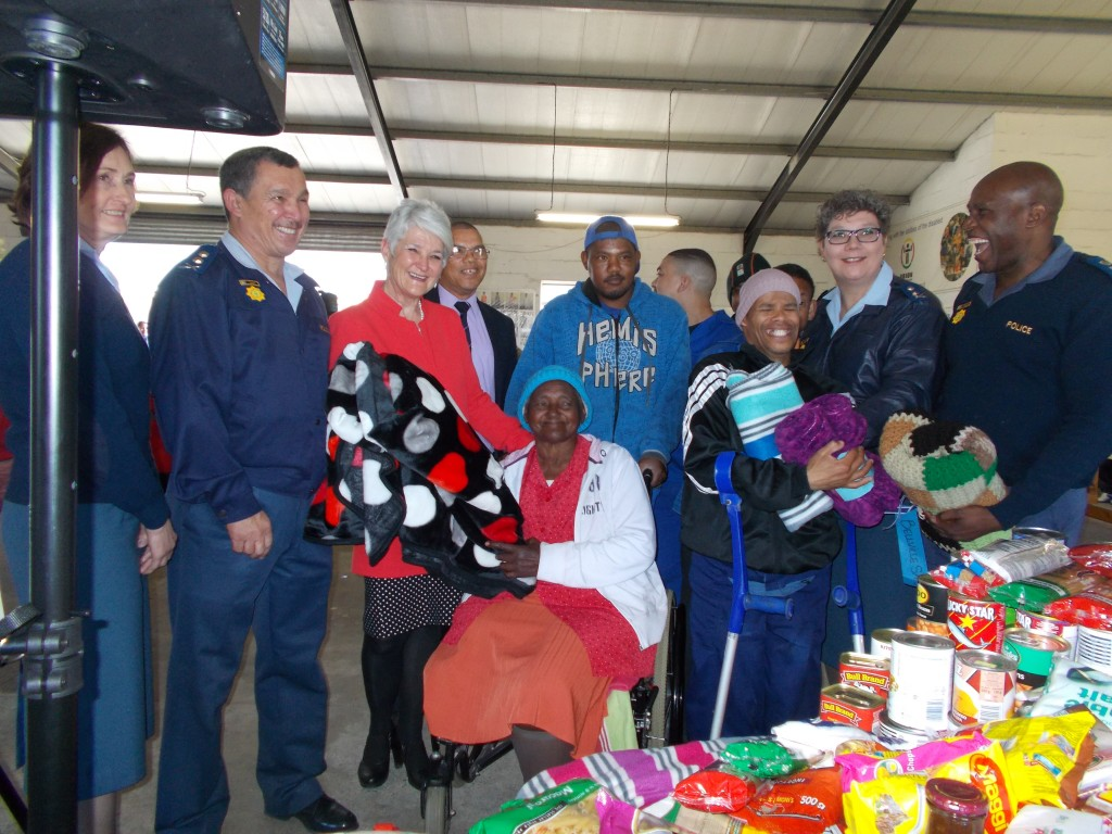SAPS Acting Provincial Commissioner, Major General Burger with some of his team handed over so much needed food/clothing and blankets to Hannl Cronje, CEO Orion Organisation NPC